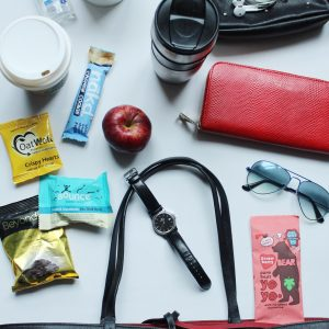 Flat lay black tote and snacks