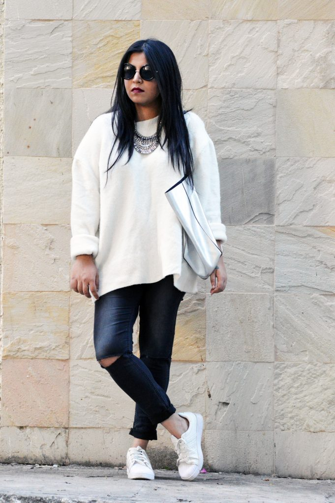 white oversized sweater , ripped jeans , white sneakers